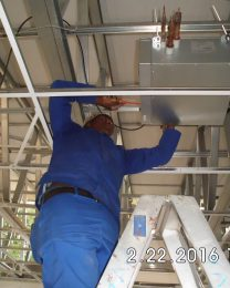 Technician istalling aircon system