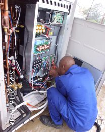 Technician during installation of the cooling systems